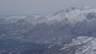 AK0001_1343 - 4K stock footage aerial video the snow covered Chugach Mountains near Eagle River, Alaska