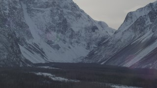 AK0001_1363 - 4K stock footage aerial video the woods at the base of the snow covered Chugach Mountains, Alaska