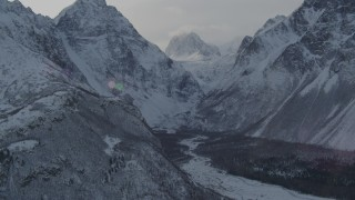 AK0001_1365 - 4K stock footage aerial video rivers and trees in snow covered Chugach Mountains, Alaska