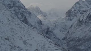 AK0001_1366 - 4K stock footage aerial video snow covered Chugach Mountains and low clouds, Alaska