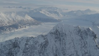 AK0001_1375 - 4K stock footage aerial video flying toward snowy ridge, Knik Glacier, Chugach Mountains, Alaska