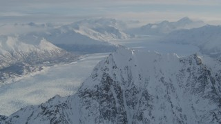 AK0001_1376 - 4K aerial stock footage video flying toward snowy ridge, Knik Glacier, Chugach Mountains, Alaska