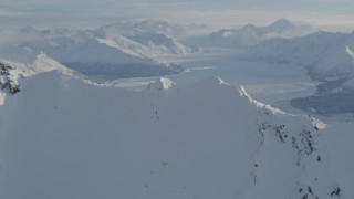 AK0001_1377 - 4K stock footage aerial video flying over snowy ridge toward the Knik Glacier, Alaska