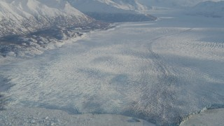 AK0001_1381 - 4K stock footage aerial video a lake between base of mountain and the Knik Glacier in snow, Alaska
