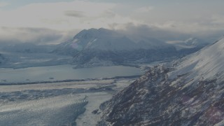 AK0001_1383 - 4K stock footage aerial video Inner Lake George between Knik Glacier and Chugach Mountains in snow, Alaska