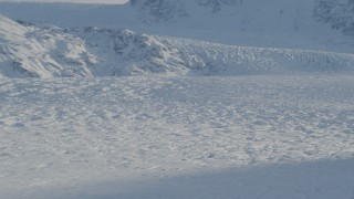 AK0001_1398 - 4K stock footage aerial video the snow covered Knik Glacier spilling down the Chugach Mountains, Alaska