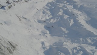 AK0001_1400 - 4K stock footage aerial video the snowy ridge along edge of Knik Glacier, Alaska