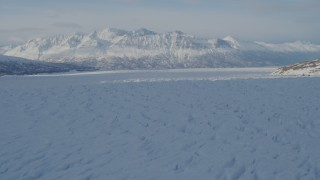 AK0001_1404 - 4K stock footage aerial video flying across surface of snow covered Knik Glacier, Alaska