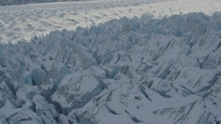 AK0001_1416 - 4K stock footage aerial video flying over jagged, snow covered surface of Knik Glacier, Alaska