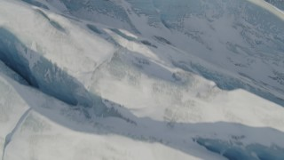 AK0001_1419 - 4K stock footage aerial video the ridged, snow covered surface of the Knik Glacier, Alaska