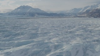 AK0001_1427 - 4K stock footage aerial video flying over snow covered surface of Knik Glacier, Alaska