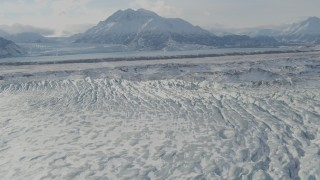 AK0001_1430 - 4K stock footage aerial video flying over snow covered Knik Glacier, Chugach Mountains in distance, Alaska