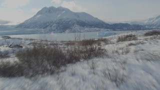 AK0001_1432 - 4K aerial stock footage video flying over the snow covered Knik Glacier revealing Inner Lake George, Alaska