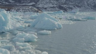 AK0001_1440 - 4K stock footage aerial video flying over glacial ice on Inner Lake George, Alaska with snow