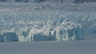 AK0001_1443 - 4K stock footage aerial video the edge of a snow covered glacier on Inner Lake George, Alaska