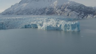AK0001_1444 - 4K stock footage aerial video flying toward edge of glacier on Inner Lake George, snow covered peak, Alaska