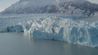 AK0001_1445 - 4K stock footage aerial video flying toward edge of glacier on Inner Lake George, snow covered peak, Alaska