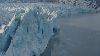 AK0001_1446 - 4K stock footage aerial video flying along edge of snow covered glacier on Inner Lake George, Alaska