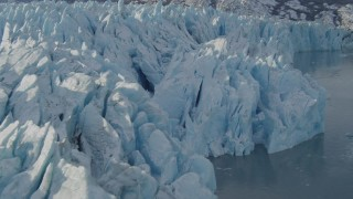 AK0001_1447 - 4K stock footage aerial video flying along edge of a snow covered glacier on Inner Lake George, Alaska