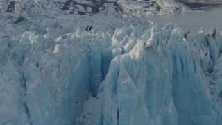 AK0001_1448 - 4K stock footage aerial video flying along edge of a snow covered glacier on Inner Lake George, Alaska