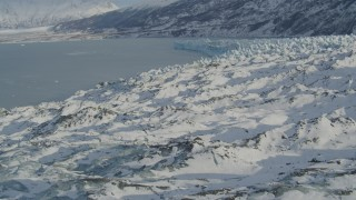 AK0001_1451 - 4K stock footage aerial video flying over surface of snow covered glacier on Inner Lake George, Alaska