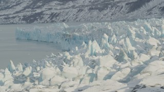 AK0001_1452 - 4K stock footage aerial video flying toward edge of the snow covered glacier on Inner Lake George, Alaska