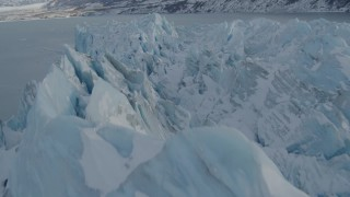 AK0001_1455 - 4K stock footage aerial video flying over snowy, jagged surface, edge of glacier on Inner Lake George, Alaska
