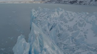 AK0001_1456 - 4K stock footage aerial video flying along edge of snow covered glacier on Inner Lake George, Alaska