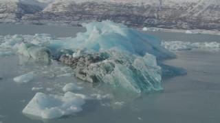 AK0001_1460 - 4K stock footage aerial video orbiting glacial ice on Inner Lake George, Alaska in snow