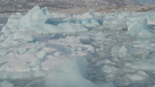 AK0001_1464 - 4K stock footage aerial video flying over pieces of ice on Inner Lake George, Alaska in snow