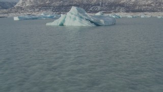 AK0001_1465 - 4K stock footage aerial video flying low over surface of Inner Lake George past glacial ice, Alaska in snow