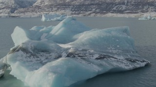 AK0001_1466 - 4K stock footage aerial video flying over surface of Inner Lake George toward pieces of glacial ice, Alaska in snow