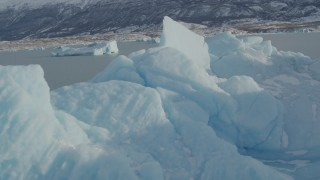 AK0001_1469 - 4K stock footage aerial video flying over a piece of glacial ice on Inner Lake George, Alaska in snow