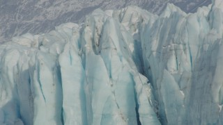AK0001_1477 - 4K stock footage aerial video approaching edge of snow covered glacier on Inner Lake George, Alaska