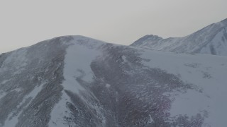 AK0001_1497 - 4K stock footage aerial video flyby a mountain peak with light snow in the Chugach Mountains, Alaska