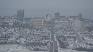 AK0001_1519 - 4K stock footage aerial video snow covered Downtown Anchorage skyline seen from East 5th Avenue, Alaska