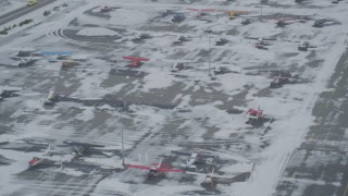 AK0001_1529 - 4K stock footage aerial video descend toward parked airplanes at snowy Merrill Field, Anchorage, Alaska