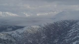 AK0001_1548 - 4K stock footage aerial video flyby snowy mountain ridges, Eklutna Lake Valley, Chugach Mountains, Alaska