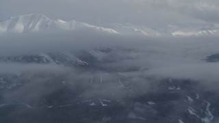 AK0001_1550 - 4K stock footage aerial video approach clouds and snowy Chugach Mountains in winter, Alaska