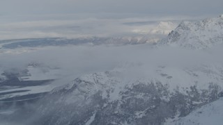 AK0001_1563 - 4K stock footage aerial video snow covered Knik Fairview, Knik River Valley from Chugach Mountains, Alaska