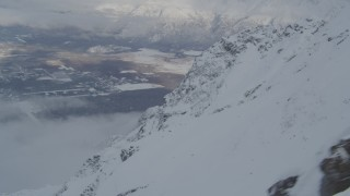 AK0001_1566 - 4K stock footage aerial video the town of Butte seen from snowy Chugach Mountains, Alaska