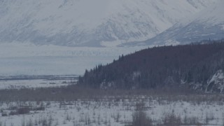 AK0001_1596 - 4K stock footage aerial video the snow covered Knik Glacier seen from Knik River Valley, Alaska