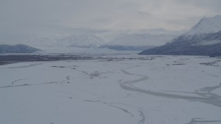 AK0001_1597 - 4K stock footage aerial video Knik Glacier, Chugach Mountains seen from snowy Knik River Valley, Alaska