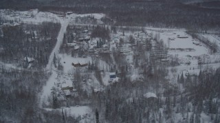 AK0001_1626 - 4K stock footage aerial video a snow covered mobile home park in Chugiak, Alaska