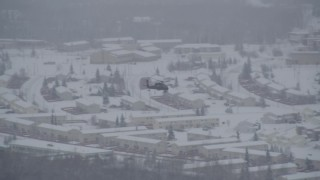 AK0001_1638 - 4K stock footage aerial video helicopter flying over snow covered Fort Richardson, Anchorage, Alaska
