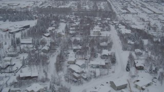 AK0001_1644 - Aerial stock footage of 4K aerial  video flying over snowy neighborhoods and mobile home parks, Anchorage, Alaska