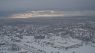 AK0001_1645 - 4K stock footage aerial video flying by snow covered neighborhoods, mobile home park, Anchorage, Alaska
