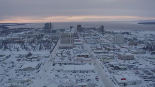 AK0001_1651 - 4K stock footage aerial video flying over snow covered Downtown Anchorage at twilight, Alaska