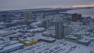 AK0001_1653 - 4K stock footage aerial video fly over snowy East Loop Road Bridge, Downtown Anchorage, Alaska, twilight