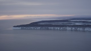 AK0001_1662 - 4K stock footage aerial video flying toward snowy Point MacKenzie at twilight, Alaska